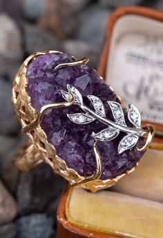 This incredible Amethyst ring is crafted of yellow Gold and set with a raw Amethyst geode. The ring is accented with seven single cut round Diamonds and is currently a size Amethyst Geode, Amethyst Jewelry, Crystal Jewelry, Diamond Jewelry, Amethyst Rings, Diamond Shapes, Diamond Cuts, Round Diamonds, Jewelery