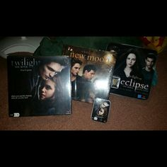 Twilight, New Moon, Eclipse, and cards games New moon and twilight are still in wrapper. Eclipse and cards have been opened but I believe all pieces are still there. I will separate. Make me an offer. Twilight Other