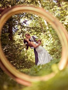 Wedding ring and bride and groom photo