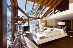 Living Room in the Spectacular Chalet Zermatt Peak in Switzerland Watching Over the Iconic Matterhorn. Designed by Paul Bowyer and located in a scenic landscape in Switzerland.