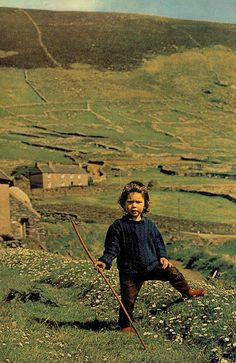 """April 1976  """"Master of the meadows: By the time Christy Fitzgerald grows up, his future may lie not in farming or emigration, but in one of the industries lured to Dingle by government grants for factory construction. By attracting business to the countryside, Ireland aims to stem the centures-long export of her young."""""""