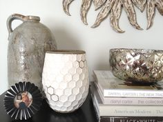 I love my tall antique looking pottery and mercury glass bowl from HomeGoods in my entry! We use the bowl to collect misc. items like keys and our dog's leash.