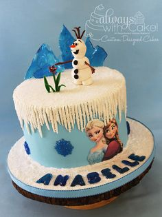 Olaf and his Flower - It's always difficult doing an original design, when something is so popular.  Ice mountains, snowflakes and lettering is done with isomalt.  Everything else is done in fondant and/or gumpaste.  TFL