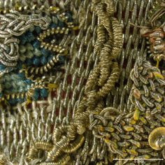 The metal wire is used round or flattened, in both round and checked purl. The checked purl has been twisted to creating a ribbed effect.  Magnification 10x. Image by Cristina Balloffet Carr. early 17th century, British. Canvas worked with silk and metal thread, glass beads, spangles; Gobelin, tent, and detached buttonhole stitches; silk cord and silk and metal thread tassels. 5 1/8 x 5 1/8 in. (13 x 13 cm) Rogers Fund, by exchange, (29.23.15)