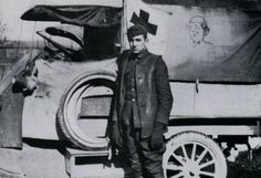 Walt Disney stands beside one of the ambulances he drove for the Red Cross in France. The doughboy caricature on the canvas side-flap of the vehicle was drawn by the budding young artist