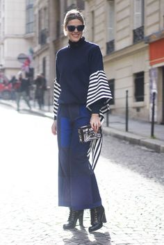 Wide-leg pants, bell-sleeve top, and ankle boots.