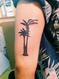 Small single needle silhouette palm tree tattoo on ankle for Palm tree ankle tattoo