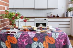 Ruusunmarja Coated Fabric | Pentik Autumn 2017 | Designed by Liina Harju, Ruusunmarja (Rosehip) pattern is like a vitamine bomb. Colourful Ruusunmarja gives a final touch to your table setting. Depending on the tableware, it is perfect both for everyday settings and celebration - and excellent for families with children. This tablecloth made of wax cloth is great in the kitchen and dining room since it is easy to clean by wiping.