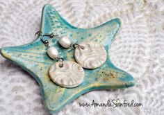 A collection of wearable works of art. All jewelry contains a pottery element formed by hand. Mississippi Cotton Tail available. Starfish Wall Decor, Pearl White, Turquoise Necklace, Original Paintings, Coin Purse, Sketches, Pottery, Ceramics, Drop Earrings