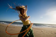 http://www.weightedhulahooping.com/   Hooping with a weighted hula hoop (or any hoop for that matter) is an excellent layer to add to your fitness regime. It's cardio. It's core strengthening. It's versatile, and can be incorporated into other workouts. It's even stretching you out. (Read on to find out how!) You can burn up to 400 calories an hour JUST from waist hooping alone!