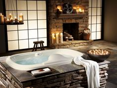 Bathroom, White Porcelain Bathtub Natural Stone Fireplace Hanging Candle Holder White Candle Stick: 8 Ideas To Deal With Rustic Bathroom Decor Rustic Master Bathroom, Rustic Bathroom Designs, Bathroom Design Luxury, Rustic Bathrooms, Bathroom Interior, Modern Bathrooms, Master Bathrooms, Built In Bathtub, Sunken Bathtub