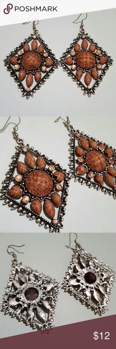 Large Pewter Diamond Earthy Statement Earrings Stunning statement earrings!  Silver is a pewter color.  Intricately detailed with the design and adorned with Earthy colored brown faceted jewels and light tan crystal rhinestones.  Silver fish hooks.  Sure to add sparkle and shine to your summer outfit!  Like new! Jewelry Earrings