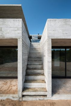 Luciano Kruk staggers board-marked concrete holiday home across sandy dune on Buenos Aires coast Concrete Architecture, Stairs Architecture, Interior Architecture, Stairs To Heaven, Concrete Houses, Building Exterior, The Dunes, Built Environment, Brutalist