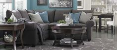 L-Shaped Sectional, grey with light blue pillows, rug too