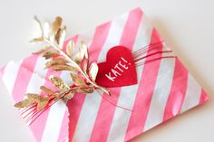 pink and white striped bag, gold floral stem + heart