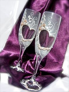 Hand painted wedding champagne glasses, elegant wedding toasting flutes, heart-shape decoration with light pink pearls and roses. $48.00, via Etsy.