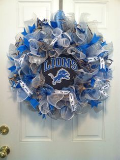 Several logos available; message me for choices!  Detroit Lions Pride! This large wreath is created on a silver mesh base and is covered in a