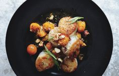 Scallops with Hazelnuts and Warm Sun Gold Tomatoes Quick-cooking scallops means you can have this light summer meal on the table in a matter... #BonAppetit