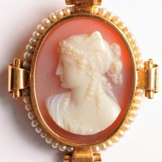Hardstone cameo of a woman in profile to the right, white on cornelian background, surrounded by pearls.  45 x 38mm.  €1800  www.osprey.fr Vintage Jewelry, Profile, Paris, Jewels, Woman, Antiques, User Profile, Antiquities, Montmartre Paris