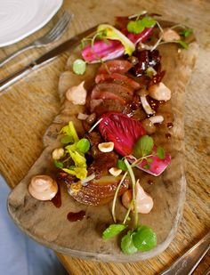 Warm salad of wood pigeon, with creamed livers, bitter leaves and turnips at the Harwood Arms in Fulham