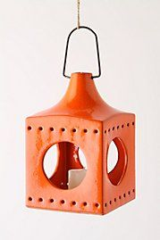 Lodestar Lantern from Anthropologie.  $28.  More colors, too.  If we got the white 4-poster bed from Ikea I'd suspend a cluster of these from the ceiling but within the framework of the posts.