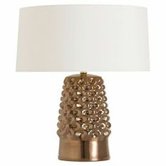 "Dimpled ceramic table lamp with a bronze finish and oversized shade.  Product: LampConstruction Material: CeramicColor: Bronze and ivoryAccommodates: (1) 150 Watt bulb - not includedDimensions: 23.5"" H x 20"" Diameter"