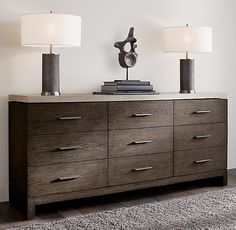 RH Modern's Meade 9-Drawer Low Extra-Wide Dresser with Concrete Top:Designed by Thomas Bina and inspired by 1970s postmodernism, the organic grain of oak provides a warm counterpoint to our nightstand's cool concrete top.