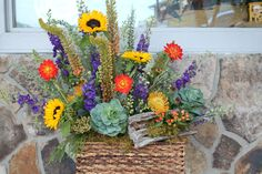 Unique Fresh Cut Design in basket with Sunflowers