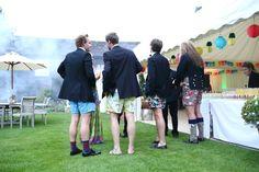 fun colourful shorts at quirky garden barn party in suffolk