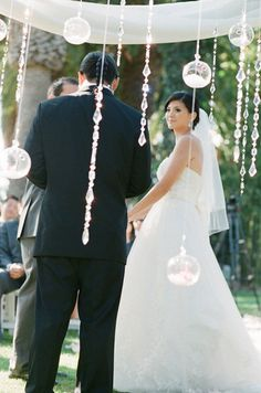 I will definitely want crystal, pearl, lace, and glass balls on my backdrop/wedding arch!