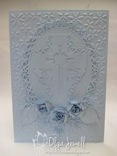 handcrafted  Easter card ... monochromatic pastel blue ... embossing folder texture background ... die cut oval frame with intricate die cut cross ...  rolled roses ... luv it!