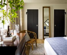 I would have never considered black interior doors -- until now. Notice how in all these examples, the door casing was left *white*. : )