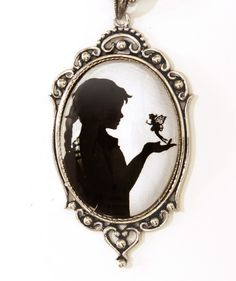 Tinker Bell and Wendy silhouette pendant.