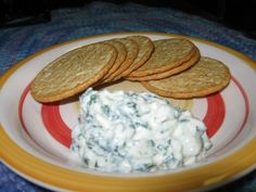 Spinach dip and crackers  Yum, spinach dip and home made too....This is my own spinach dip recipe and to tell you the truth it is addicting, and shhhhhh....even my kids like it. Try out this recipe it's a great dip for the obvious pumpernickle...