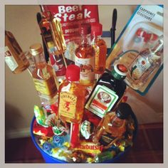 How to make a Man Bouquet. Candy, alcohol, beef jerky and other manly items. Perfect for Fathers Day.