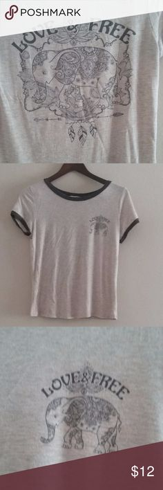 """Love & Free Elephant Tshirt Juniors Medium Super cute Love & Free elephant tshirt with small graphic on front and the larger graphic is on the back.  Made by Mccnchild size medium, measures approximately 20.5"""" long from back collar and 17"""" underarm to underarm. Mccnchild Tops Tees - Short Sleeve"""