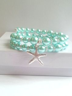 Pearl bracelet, starfish charm jewelry, memory wire wrap with seafoam light turquoise pearls. Would love to make something similar for my wedding jewelry ♡ Memory Wire Jewelry, Memory Wire Bracelets, Charm Jewelry, Jewelry Crafts, Bangle Bracelets, Beaded Jewelry, Handmade Jewelry, Silver Bracelets, Jewelry Ideas
