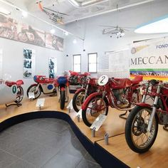 To visit the official MV Agusta museum, you don't head towards this famous motorcycle manufacturer's current factory in Varese, Italy. After you get off the plane at Milan's Malpensa airport, you only need to travel a few miles east to the town of Cascina Costa di Samarate. Motorcycle Touring, Motorcycle Manufacturers, Mv Agusta, Honda S, Car Makes, Moto Guzzi, Racing Team, Road Trips, Grand Prix