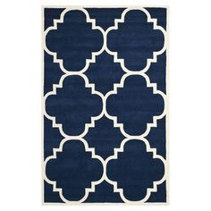 Anchor your living room seating group or define space in the den with this artfully hand-tufted wool rug, featuring a linked medallion motif for eye-catching...AURORA ROUND RUG in DARK BLUE & IVORY
