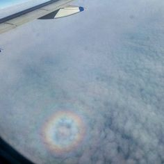 Feast your eyes. Never seen a rainbow circle. I guess this is how it looks when you see it from upside down.
