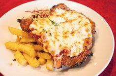 Crumbed and fried meat is usually a winner in our books—but these Sydney pubs are doing it that much better than the rest. Chicken Parmigiana, Cafe Restaurant, The Good Place, Sydney, Meat, Breakfast, Urban, Exploring, Books