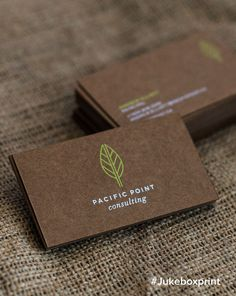 Elegantly produced Brown Kraft Business Cards with White & Neon Green Silkscreen Printing. Designed by Cosette. Produced by Jukebox Print