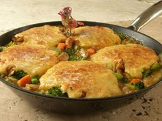 Skillet Chicken Pie with chicken, potatoes, broccoli, peas and carrots in gravy with a cornmeal crust
