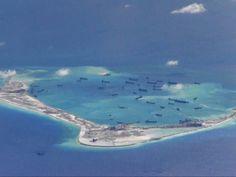 Embarcações de dragagem chinesas vistas nas águas em torno do recife Mischief nas Ilhas Spratly, área disputada no sul do Mar da China