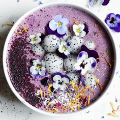 Violet Smoothie Bowl 1/2 cup frozen blueberries 1 frozen banana 1 tablespoon chia seeds A handful of spinach 1/2 cup plain yogurt 1/2 cup unsweetened almond milk (or your choice of milk) 1/2 cup rolled oats Blend all in a blender and top with dried blueberries and any toppings you like.