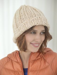 Check out this classic ribbed knit hat in Heartland Thick & Quick.  Great for guys or girls.