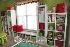 Ikea Expedit shelving units-used horizontally and vertically. (wall paint color: SW Parakeet)
