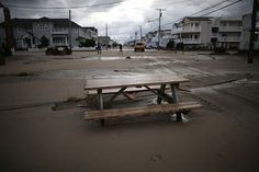 OCEAN CITY, NJ - OCTOBER 30: A picnic table sits on a sand covered road after Hurricane Sandy on October 30, 2012 in Ocean City, New Jersey. Sandy made landfall last night on the New Jersey coastline bringing heavy winds and record floodwaters. At least two dozen people were reported killed in the United States as millions of people in the eastern United States are experiencing widespread power outages, flooded homes and downed trees. (Photo by Mark Wilson/Getty Images)
