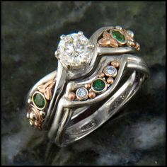 Unique irish engagement ring in White nad Rose Gold set with a diamond and tsavorites.
