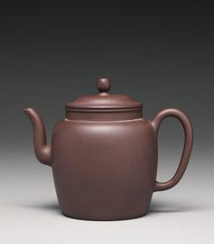 A YIXING TEAPOT AND COVER with gently bulging sides tapering towards the recessed base, set with a short spout opposite the loop handle, the base incised Chongzhen renwu nian Yongqing zhi (made by Yongqing during renwu year of Chongzhen' reign, corresponding to 1642), the low domed cover surmounted by an oval knop Height 4 3/4 in., 12 cm 10/15000